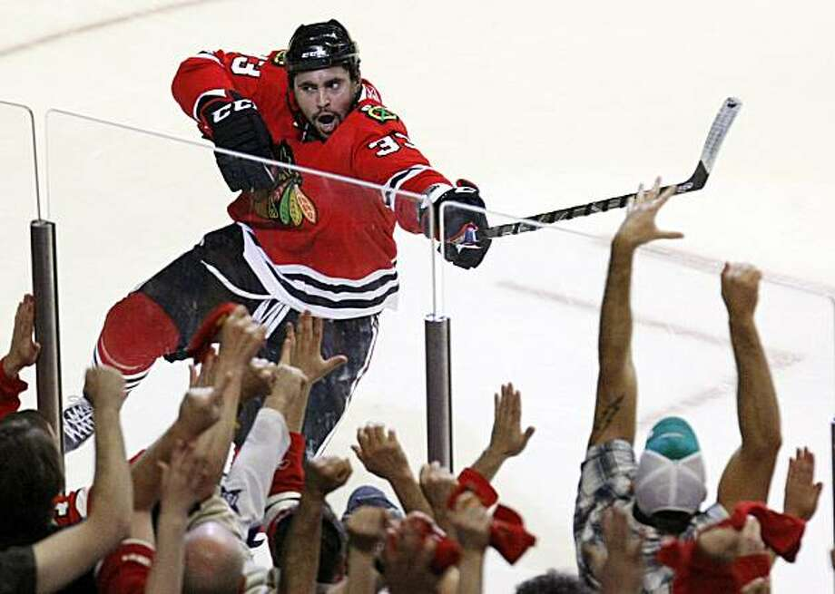 Chicago Blackhawks right wing Dustin Byfuglien celebrates after scoring goal against the San Jose Sharks during third period hockey action in Game 4 of the  NHL Western Conference final Sunday, May 23, 2010 in Chicago. Photo: Charles Rex Arbogast, AP