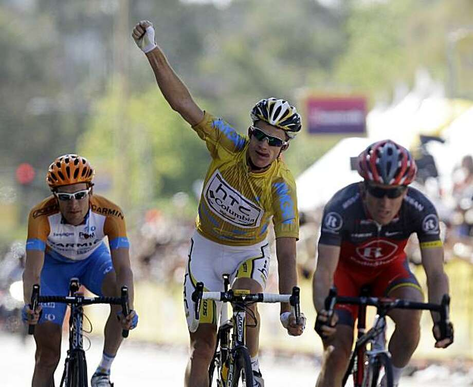 Michael Rogers, center, of Australia, celebrates at the finish line of the final stage, as he wins the Tour of California cycling race Sunday, May 23, 2010, in Thousand Oaks, Calif. David Zabriskie, left, of the United States, finished in second overall,and Levi Leipheimer, right, also of the United States, finished in third. Ryder Hesjedal, of Canada, won the stage. Photo: Marcio Jose Sanchez, AP