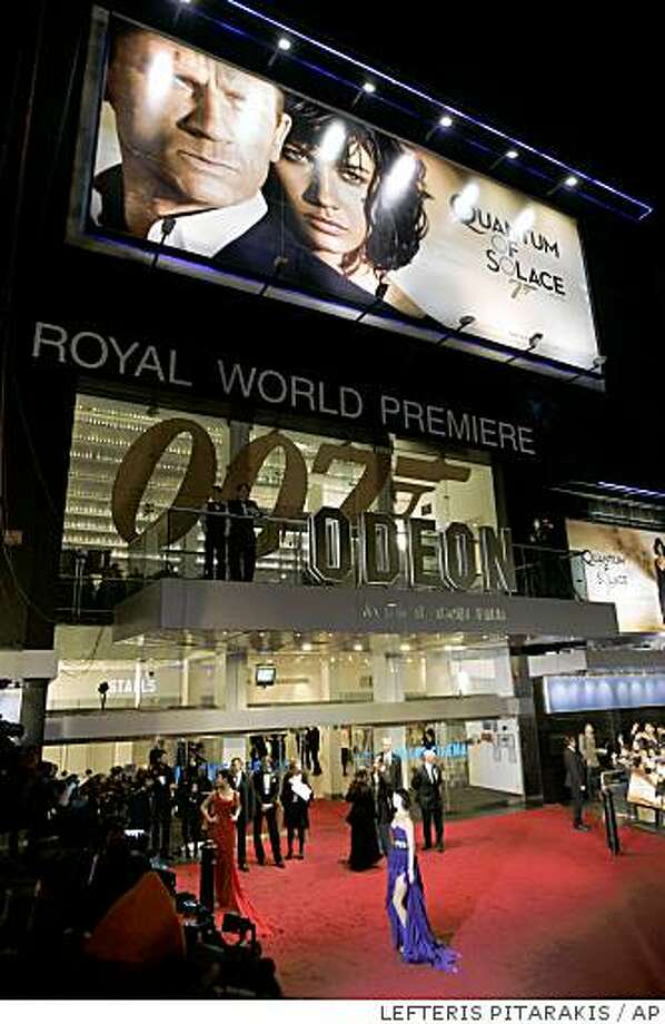 Stars arrive for the Royal World Premiere of the 22nd James Bond film 'Quantum of Solace' in a central London's cinema, Wednesday Oct. 29, 2008. (AP Photo/Lefteris Pitarakis) Photo: LEFTERIS PITARAKIS, AP
