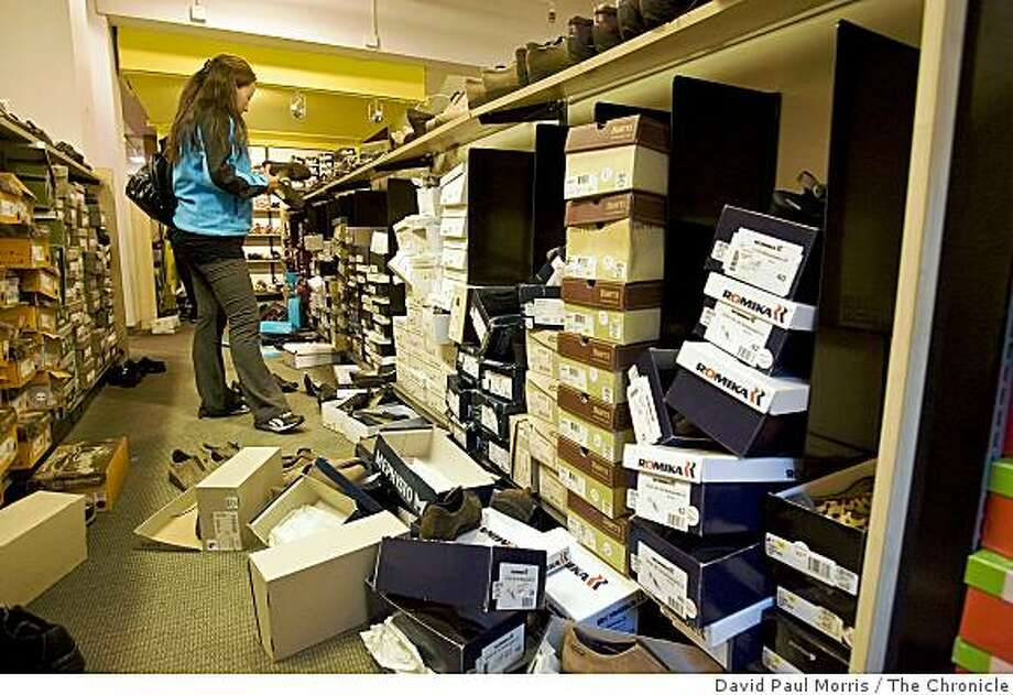 Tashi Yangzom looks over shoes as she takes advantage of a liquidation sale at the Shoe Pavilion shoe store on Market Street, October 28, 2008 in San Francisco, California. Photograph by David Paul Morris / The Chronicle Photo: David Paul Morris, The Chronicle
