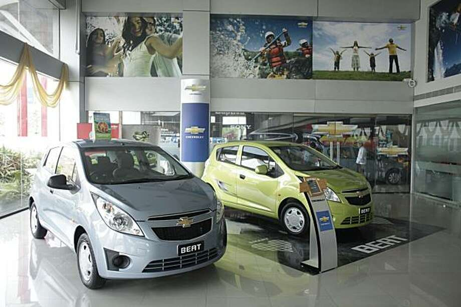 General Motors Co. Chevrolet cars are displayed in a showroom in Pune, India, on Tuesday, May 18, 2010. In India, GM eventually plans to make light trucks at a plant in Halol, Gujarat state, which has the capacity to build 85,000 vehicles a year. Initially, production will take place in Talegaon in Maharashtra state at a factory that makes models including Chevrolet Beat cars and Tavera sport-utility vehicles. Photographer: Adeel Halim/Bloomberg Photo: Adeel Halim, Bloomberg