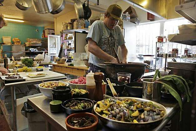 Chef Roger Feely prepares rice in the open kitchen at the La Victoria Bakery, Thursday May 13, 2010, in San Francisco, Calif. At least once a month the Bakery has an exclusive vegan menu. Photo: Lacy Atkins, The Chronicle