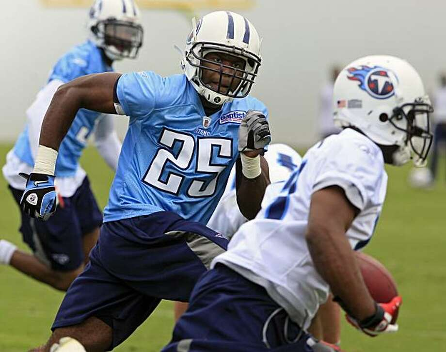 Tennessee Titans safety Myron Rolle (25) closes in on running back Stafon Johnson, right, during NFL football minicamp practice Tuesday, May 18, 2010, in Nashville, Tenn. The Titans are trying to improve their defense after missing the playoffs last season with an 8-8 record. Photo: Mark Humphrey, AP
