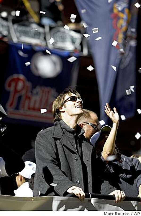 Philadelphia Phillies Cole Hamels is seen as he, the team and the Phillies organization heads south down Broad Street during a jubilant victory parade in downtown Philadelphia Friday Oct. 31, 2008. Hundreds of thousands of spectators packed downtown for Friday's parade celebrating the Phillies World Series victory against the Tampa Bay Rays.  (AP Photo/Matt Rourke) Photo: Matt Rourke, AP