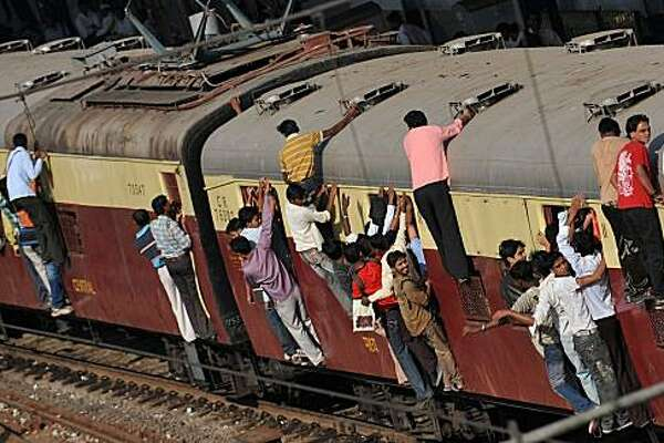 Commuters travel by local train in Mumbai on February 24, 2010. The Indian railways, begun 156 years ago by Britain's colonial rulers -- still the main form of long-distance travel in the country of billion-plus people despite fierce competition from new private airlines -- runs 14,000 passenger and freight trains and carries 18.5 million people daily.