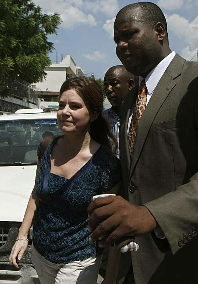 U.S. missionary Laura Silsby, left, leaves a courthouse in Port-au-Prince, Monday, May 17, 2010. Silsby, the last of 10 Americans detained while trying to take 33 children out of Haiti following the Jan. 12 earthquake, was released after a judge convictedher and sentenced her to the time she had already served in jail. Photo: Esteban Felix, AP