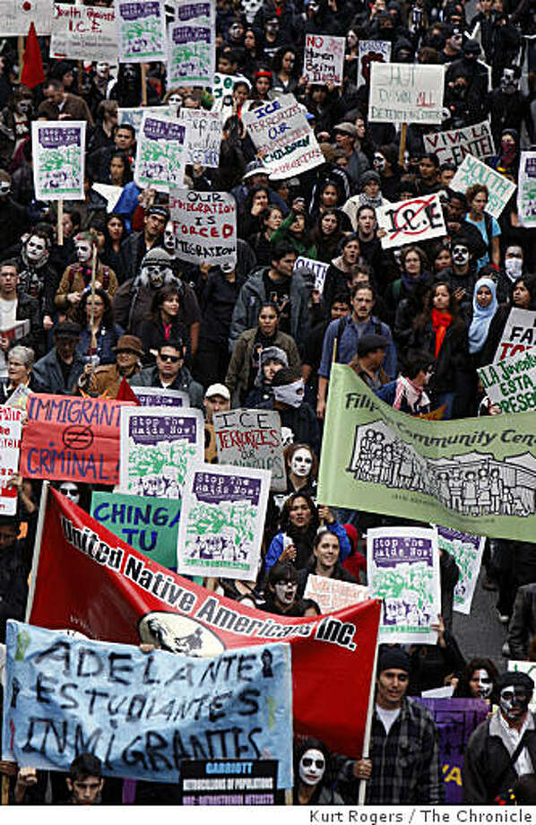 Protesters marched up Washington Street on their way to the the United States Immigration and Customs Enforcement building in San Francisco to protest ICE raids. Photo: Kurt Rogers, The Chronicle