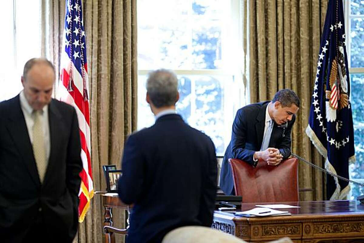 President Barack Obama makes phone calls from the Oval Office with Chief of Staff Rahm Emanuel and Assistant to the President for Legislative Affairs Phil Schiliro present 4/24/09. Official White House Photo by Pete Souza