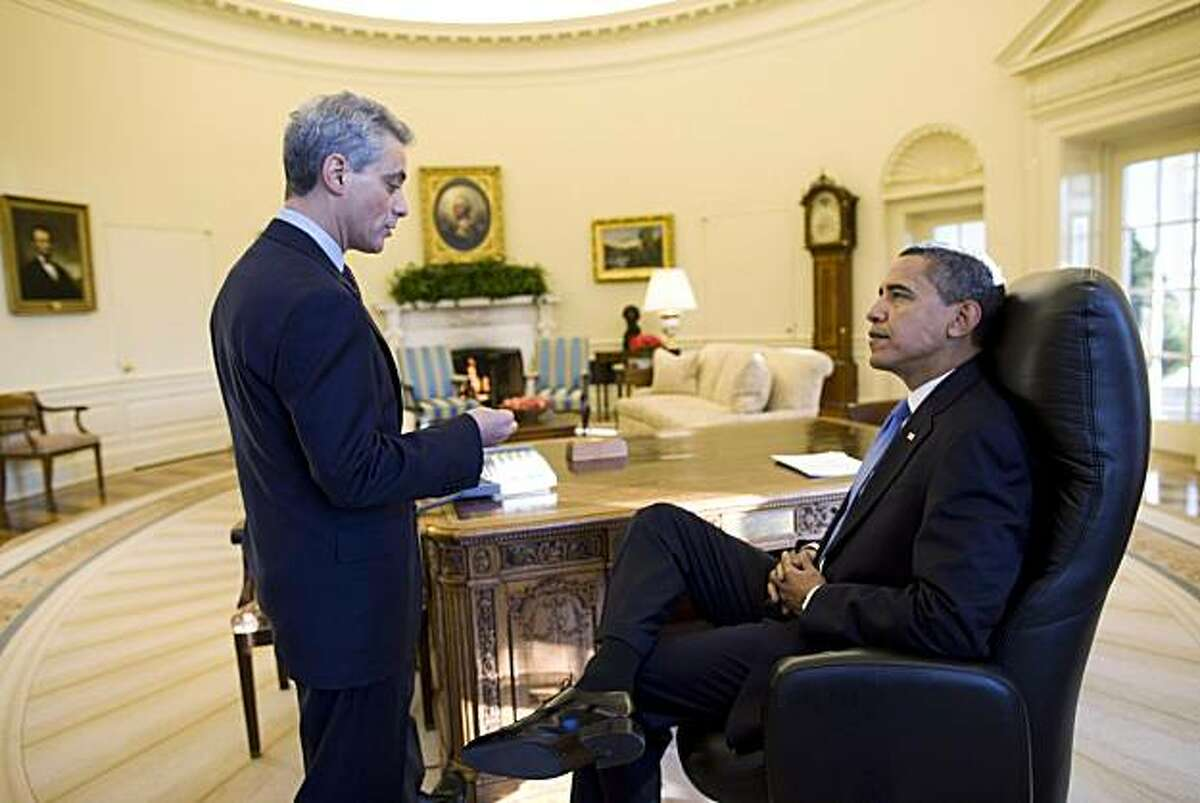 WASHINGTON - JANUARY 21: In this handout from the White House, U.S. President Barack Obama (R) talks with White House Chief of Staff Rahm Emanuel in the Oval Office of the White House in the morning January 21, 2009 in Washington, DC. This is the first complete day of Obama's administration. (Photo by Pete Souza/White House via Getty Images)
