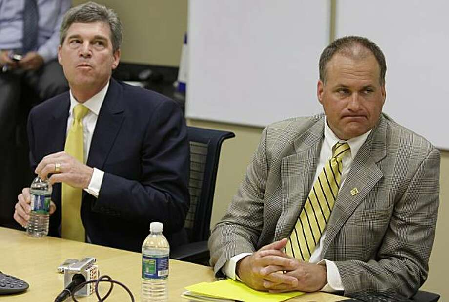 University of Michigan athletic director David Brandon, left, and head football coach Rich Rodriguez look on during a tele-conference on Tuesday, May 25, 2010 in Ann Arbor, Mich.  The university admitted Tuesday to a series of violations in its storied football program and insisted the problems related to practice time and the activities of graduate assistants were not enough to warrant major punishment from the NCAA. Photo: Julian H. Gonzalez, AP
