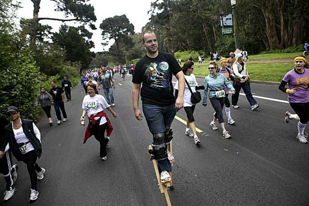 David Strine of San Francisco makes his way through Golden Gate Park during Bay to Breakers in San Francisco on Sunday. Strine said he did about half the course on stilts. Photo: Lea Suzuki, The Chronicle