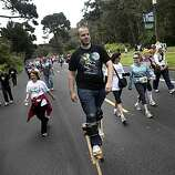 David Strine of San Francisco makes his way through Golden Gate Park during Bay to Breakers in San Francisco on Sunday. Strine said he did about half the course on stilts.