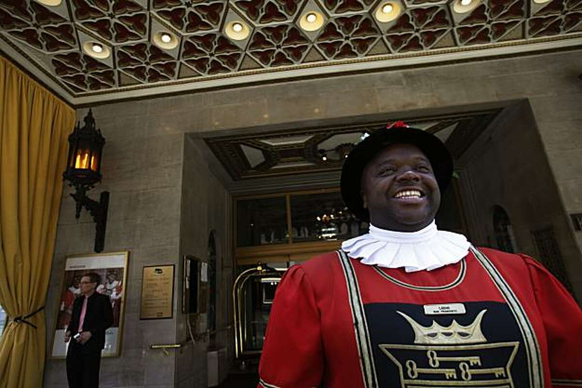 Laban Wade, who's been manning the door at the Sir Francis Drake Hotel for 10 years, smiles from his usual post on Thursday May 20, 2010 in San Francisco, Calif. The Hotel is up for sale and group of investors from China are said to be interested in a purchasing it.