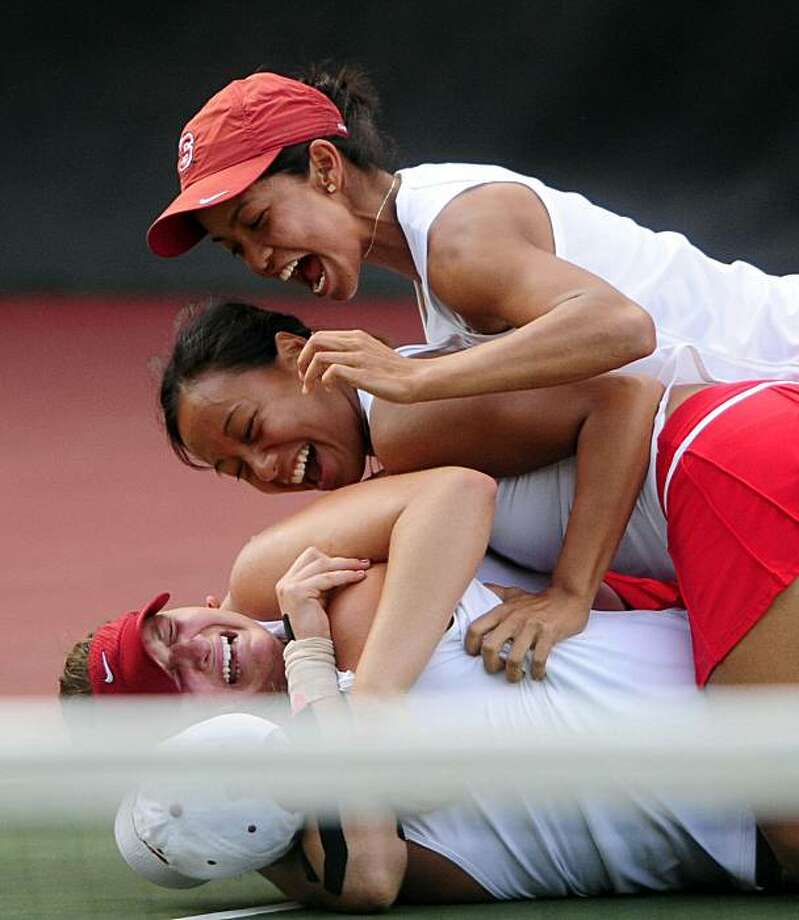 Stanford's Mallory Burdette, bottom, facing camera, is hugged by her sister as her teammates pile on as Stanford beat Florida 4-3 to win the NCAA women's Division I tennis championships Tuesday, May 25, 2010, in Athens, Ga. Burdette defeated Florida's Marrit Boonstra, 6-4, 6-7 (4), 7-5. Photo: David Manning, AP