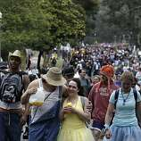 Joseph Martinez II of Palo Alto and Maya Steward of Novato make their way through Golden Gate Park during Bay to Breakers in San Francisco on Sunday.