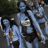 Sheree Birch of Livermore, Jacki Rooney of Livermore and Brooke Westling of San Francisco walk during Bay to Breakers in San Francisco on Sunday.