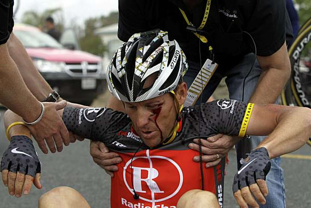 Cyclist'sLance Armstrong is helped up after crashing during the fifth stage of the Tour of California cycling race in the outskirts of Visalia, Calif., Thursday, May 20, 2010.
