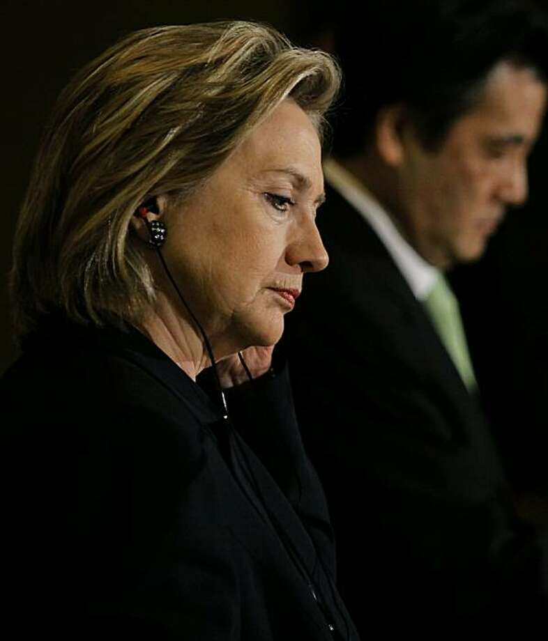 TOKYO - MAY 21: U.S. Secretary of State Hillary Rodham Clinton listens to her Japanese counterpart Katsuya Okada during a joint news conference nat the Foreign Ministry's Iikura guesthouse May 21, 2010 in Tokyo, Japan. Clinton, on a week-long tour of Asia, spoke of the sinking of a South Korean Navy warship, which according to reports was sunk by a North Korean torpedo in March, and promised to marshall an international response. Photo: Pool, Getty Images
