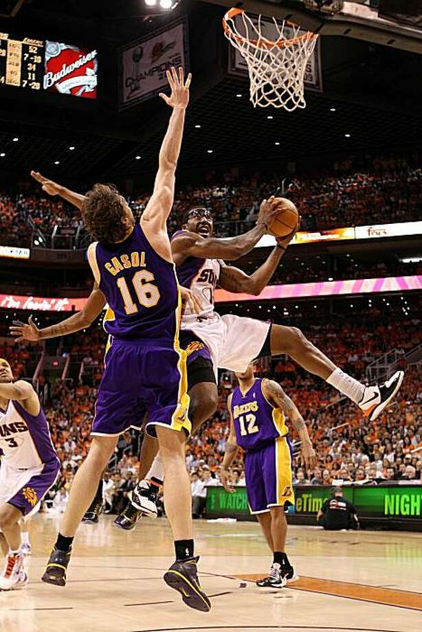 PHOENIX - MAY 23:  Amar'e Stoudemire #1 of the Phoenix Suns goes up for a shot against Pau Gasol #16 of the Los Angeles Lakers in Game Three of the Western Conference Finals during the 2010 NBA Playoffs at US Airways Center on May 23, 2010 in Phoenix, Arizona. Photo: Christian Petersen, Getty Images