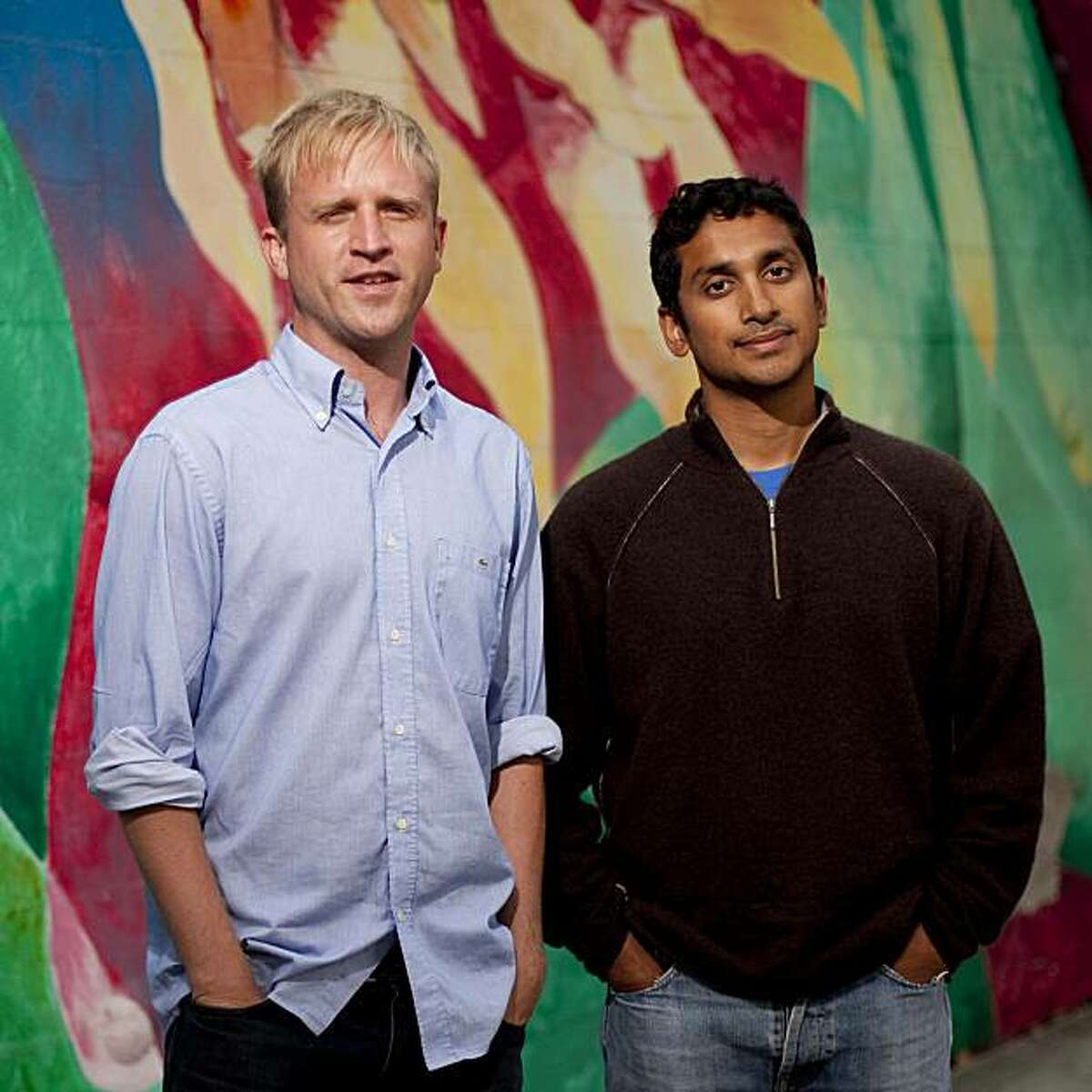 Kiva co-founder Matt Flannery, left, and president Premal Shah, right stands for a portrait at a mural near their office on Harrison Street in San Francisco's Mission District in on Tuesday, Aug. 11, 2009.