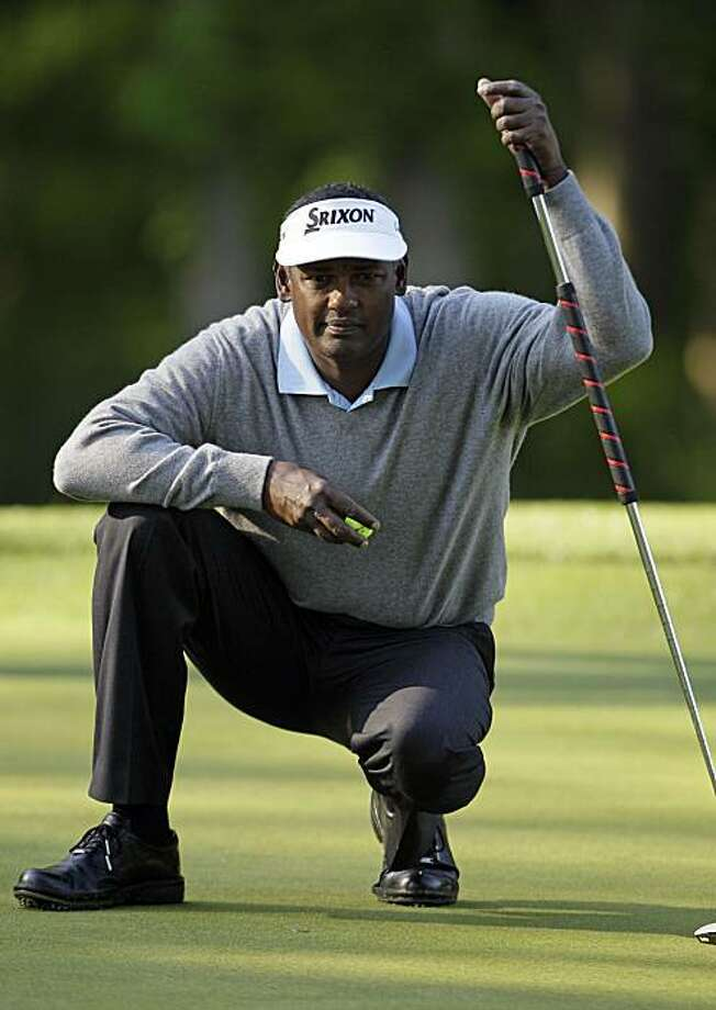 Vijay Singh lines up a putt on the 12th green during the second round of the Quail Hollow Championship golf tournament at Quail Hollow Club in Charlotte, N.C., Friday, April 30, 2010. Photo: Gerry Broome, AP