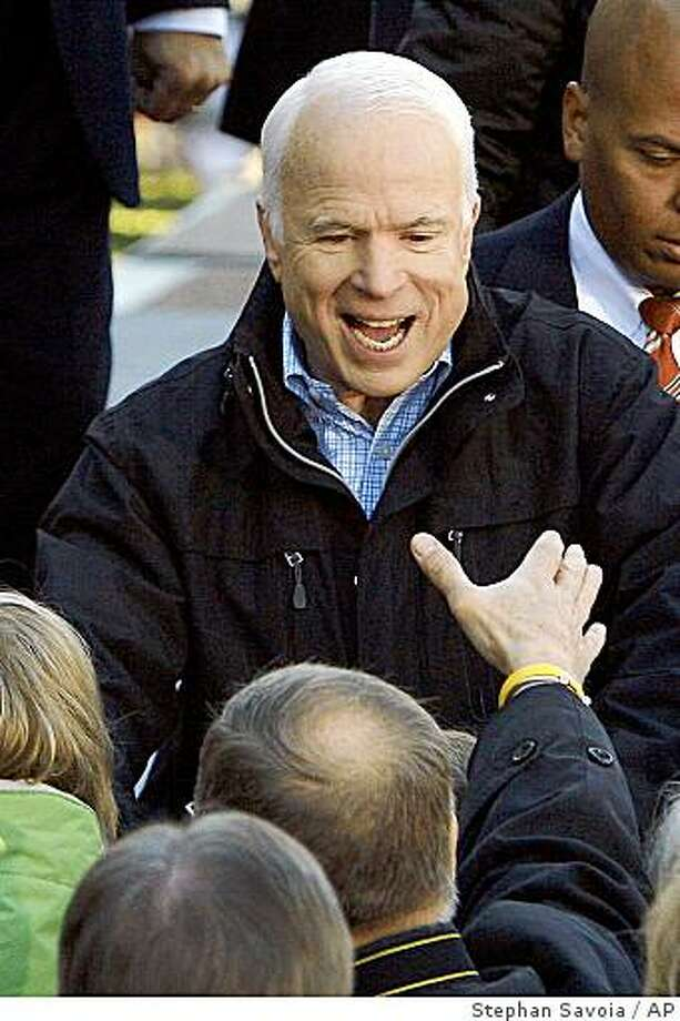 Republican presidential candidate Sen. John McCain, R-Ariz. greets supporters at the conclusion of a campaign rally at Defiance Junior High School in Defiance, Ohio., Thursday, Oct. 30, 2008. (AP Photo/Stephan Savoia) Photo: Stephan Savoia, AP