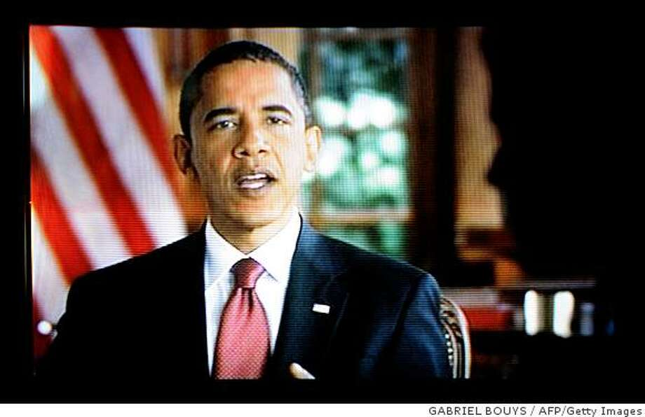 US Democratic presidential candidate Barack Obama speaks during a 30-minute prime-time infomercial on October 29, 2008.  Obama delivered a 30-minute campaign pitch on national television, ending with a live cut to the thumping climax of a rally attended by 20,000 supporters, on the final stretch of his bid to be America's first black president.  AFP PHOTO / GABRIEL BOUYS (Photo credit should read GABRIEL BOUYS/AFP/Getty Images) Photo: GABRIEL BOUYS, AFP/Getty Images