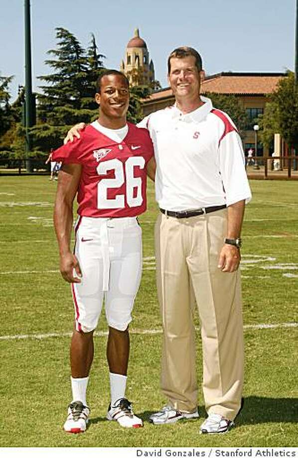 STANFORD, CA - AUGUST 10: Delano Howell poses with the head coach during picture day on August 10, 2008 at Elliott Field in Stanford, California. Photo: David Gonzales, Stanford Athletics