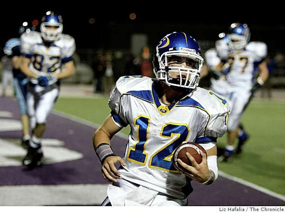 Serra's quarterback Cody Jackson takes a 45-yard run into the endzone for a score in the second quarter of the 31-23 victory over the Bellarmine Bells at San Jose City College in San Jose, Calif., on Friday, October 24, 2008. Photo: Liz Hafalia, The Chronicle