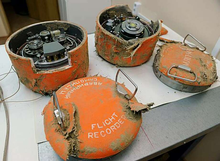 The flight recorders from the plane of Polish President Lech Kaczynski sit on a table at the headquarters of the inter-state air committee in Moscow on May 19, 2010.  Non-crew members were in the cockpit of the plane of Polish president Lech Kaczynski before its fatal crash in Russia, officials said, raising fresh questions about the tragedy's cause. The aviation committee investigating the April 10 crash -- Poland's worst post-World War II disaster -- also revealed the jet's crew had ignored repeated warnings that weather conditions were not suitable for landing. Photo: Natalia Kolesnikova, AFP/Getty Images
