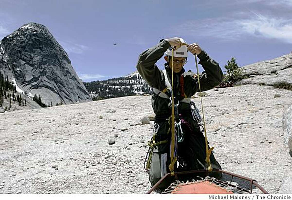 John Dill, 69 years old, checks his safety gear prior to the short haul training in Yosemite National Park on May 24, 2007. Dill is a member of the Yosemite National Park's Search and Rescue Team