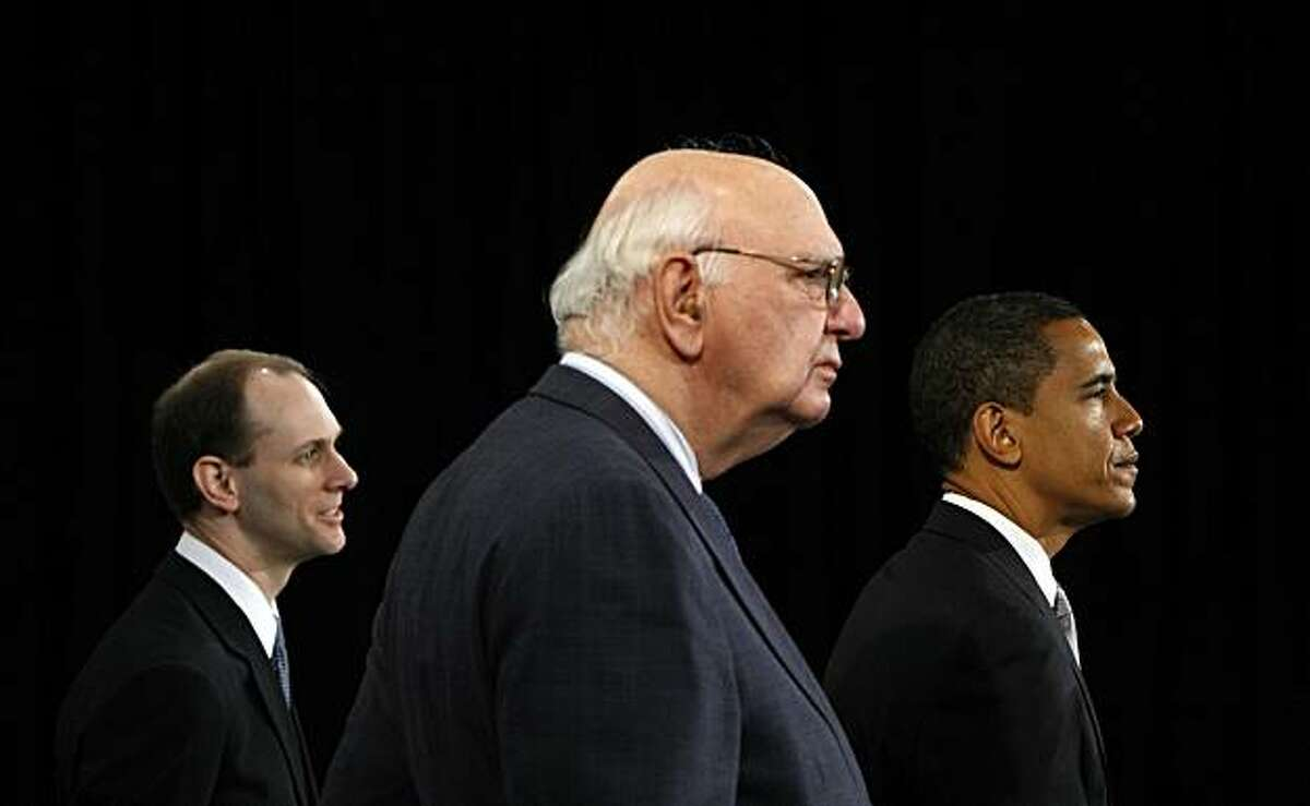 President-elect Barack Obama, right, stands with former Federal Reserve Chairman Paul Volcker, center, chairman-designate of the Economic Recovery Advisory Board, center, and chief economist-designate Austan Goolsbee, left, as he speaks at a news conference in Chicago, Wednesday, Nov. 26, 2008. (AP Photo/Pablo Martinez Monsivais)