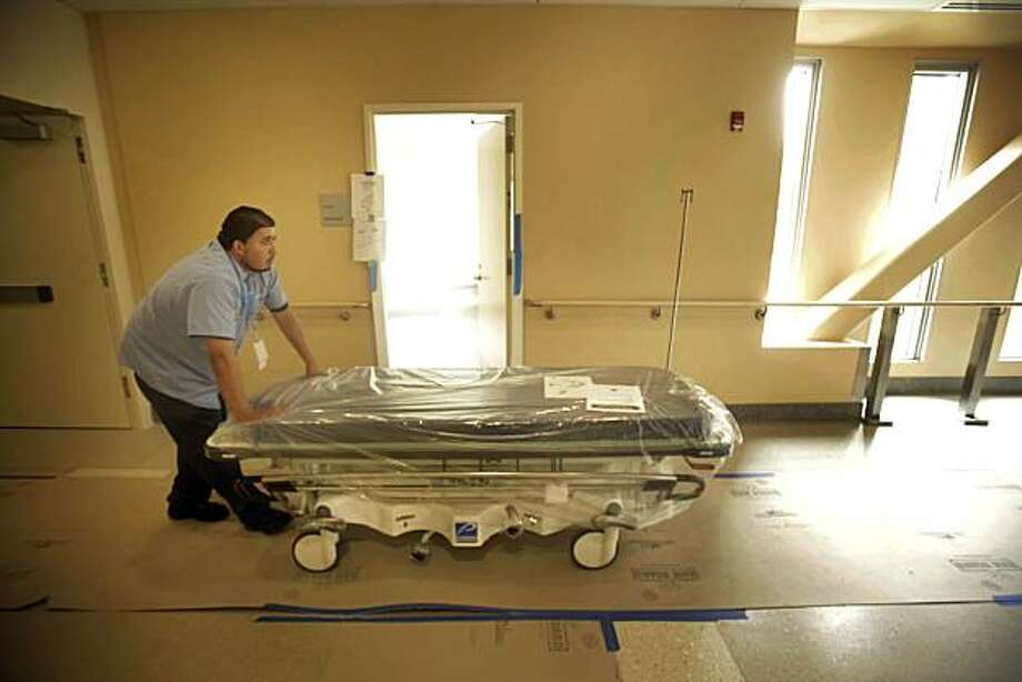 Jose Franco rolls equipment through the South Residence at the new Laguna Honda Hospital in San Francisco, Calif. on Tuesday May 18, 2010. Photo: Lea Suzuki, The Chronicle