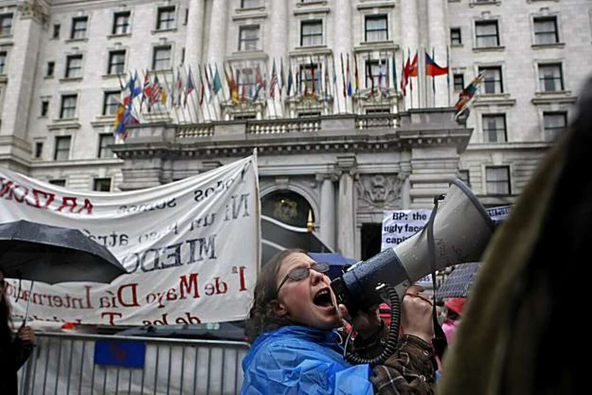 Sarah Carlson leads the crowd of about 250 in protest of the administration outside the Fairmont Hotel, where President Obama made an appearance Tuesday.