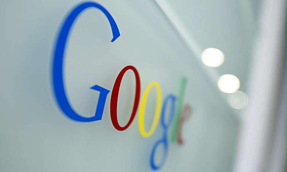 The Google logo is seen at the Google headquarters in Brussels, Tuesday March 23, 2010. European regulators are investigating whether the common practice on Facebook, Google and other sites to post photos and information on individuals without their consent is a breach of privacy laws. Photo: Virginia Mayo, AP