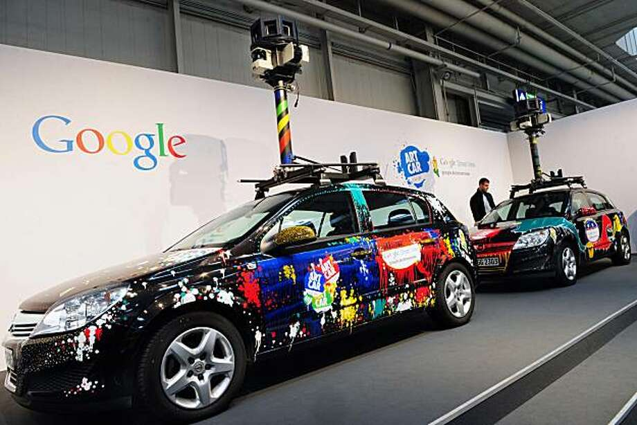 (FILES) - Picture taken on March 3, 2010 shows cars equiped with special cameras, used to photograph whole streets, at the Google street-view stand at the world's biggest high-tech fair, the CeBIT in the northern German city of Hanover. Some 4,157 companies from 68 countries are displaying their latest gadgets at the fair taking place from March 2 to 6, 2010. Photo: Daniel Mihailescu, AFP/Getty Images