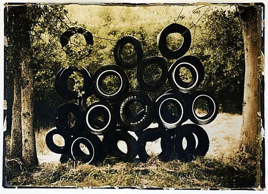 """Photographer Brian Taylor escapes the crazed pace of modern life with treks to the woods, then uses retro techniques to render the resulting scenes, including """"Tires, Family Camp.Sierra Nevada."""" Photo: Brian Taylor"""