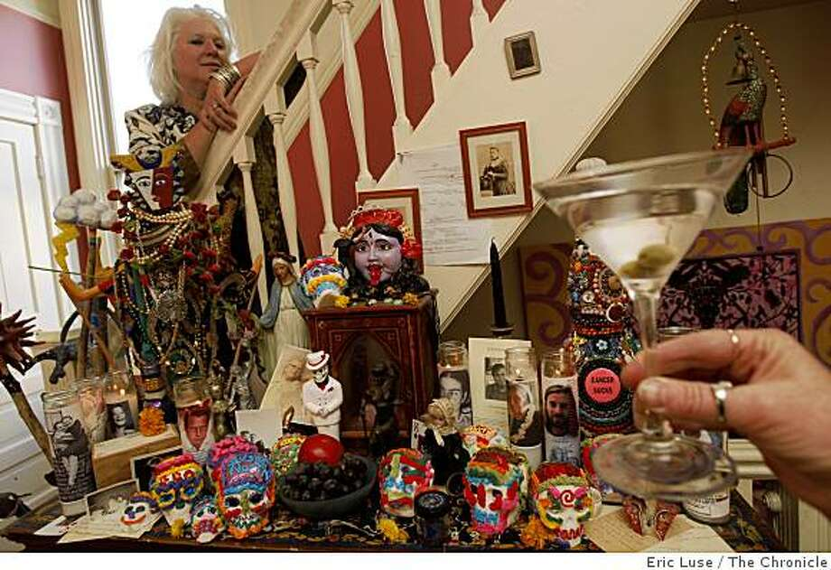 Once a year, for the holiday of Samhain, Deborah Cooper, makes a martini for her father DeWitt Cooper who passed away at 46. She has altars through her house  in San Francsico. Photo: Eric Luse, The Chronicle
