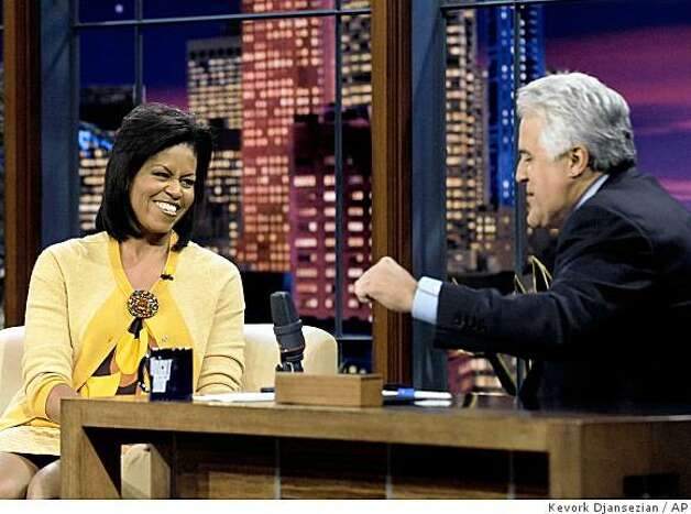 "Comedian Jay Leno, right, interviews Michelle Obama, wife of Democratic presidential candidate Sen. Barack Obama, D-Ill., during taping of ""The Tonight Show with Jay Leno"" at NBC Studios in Burbank, Calif. on Monday, Oct. 27, 2008. Photo: Kevork Djansezian, AP"