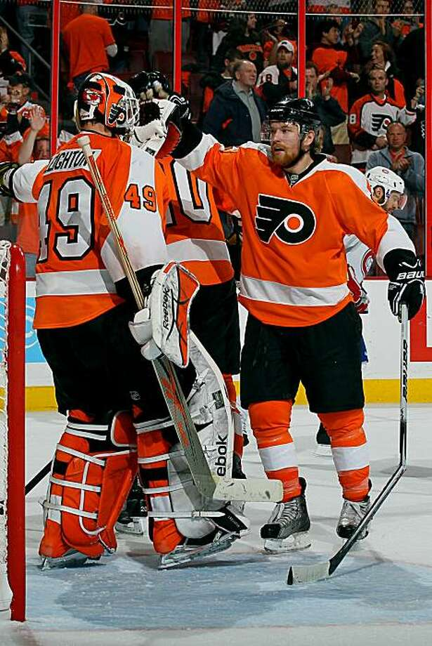PHILADELPHIA - MAY 18:  Michael Leighton #49 and Claude Giroux #28 of the Philadelphia Flyers react after defeating the Montreal Canadiens by a score of 3-0 to win Game 2 of the Eastern Conference Finals during the 2010 NHL Stanley Cup Playoffs at Wachovia Center on May 18, 2010 in Philadelphia, Pennsylvania. Photo: Jim McIsaac, Getty Images
