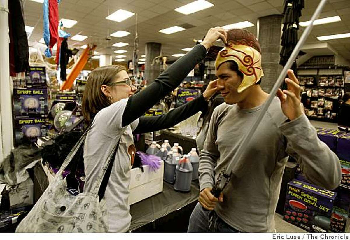 Jaylene Shelby and Jorge Flores of San Francisco, consider a gladiator costume from the Spirit Halloween store in San Francisco on Tuesday, October 28, 2008.
