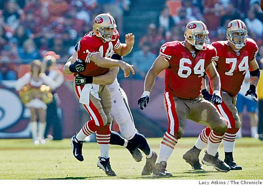San Francisco 49ers quarterback J.T. Sullivan gets rid of the ball before being tackles by the  Seattle Seahawks defense in the first half of the game, at Candlestick Park, Sunday Oct. 26, 2008, in San Francisco, Calif. Photo: Lacy Atkins, The Chronicle