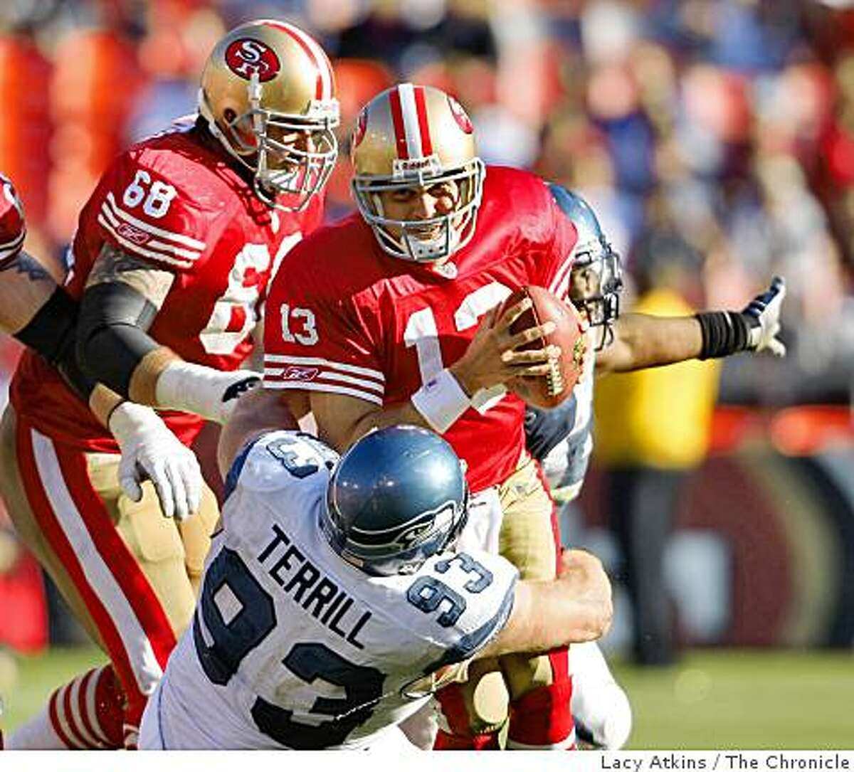 San Francisco 49ers quarterback Shaun Hill is sacked in the fourth quarter by Seattle Seahawks Craig Terrill, at Candlestick Park, Sunday Oct. 26, 2008, in San Francisco, Calif.