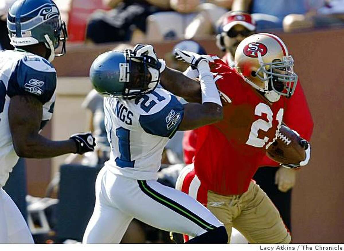 San Francisco 49ers Frank Gore gets a first down in the first half but then the play is called back because of a flag for facemask against Seattle Seahawks' Kelly Jennings, at Candlestick Park, Sunday Oct. 26, 2008, in San Francisco, Calif.
