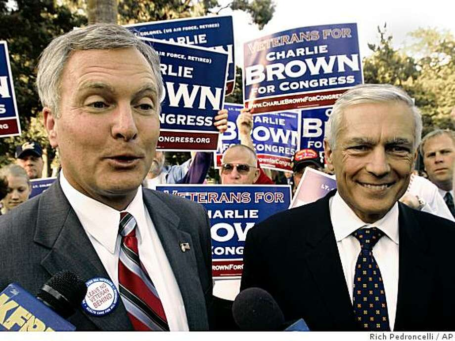 Democratic Congressional candidate Charlie Brown, left, talks to reporters after appearing with retired Army Gen. Wesley Clark, right, at the Vietnam Veterans Memorial in Sacramento, Calif., Monday, Oct. 2, 2006. Clark attended the event to show his support for Brown, a retired Air Force Lt. Col. who is running against eight-term incumbent Republican, John Doolittle.(AP Photo/Rich Pedroncelli) Democratic Congressional candidate Charlie Brown, left, talks to reporters after appearing with retired Army Gen. Wesley Clark, right, at the Vietnam Veterans Memorial in Sacramento, Calif., Monday, Oct. 2, 2006. Clark attended the event to show his support for Brown, a retired Air Force Lt. Col. who is running against eight-term incumbent Republican, John Doolittle.(AP Photo/Rich Pedroncelli) Photo: Rich Pedroncelli, AP