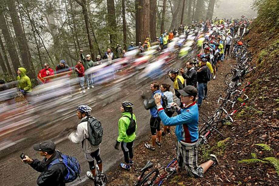 Waldo Williams of San Francisco (bottom center) photographs the peloton as it up zooms up Tunitas Creek Road during Stage 3 of the 2010 Amgen Tour of California on Tuesday in San Francisco. Photo: Michael Macor, The Chronicle