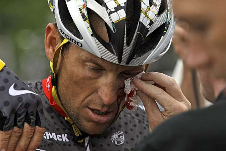 Cyclist Lance Armstrong is tended to after crashing during the fifth stage of the Tour of California cycling race in the outskirts of  Visalia, Calif., Thursday, May 20, 2010. Photo: Marcio Jose Sanchez, AP