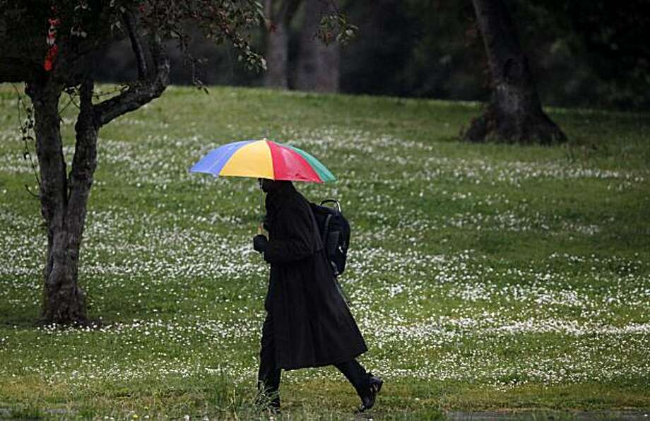 James Mason uses his umbrella to a combat  a late spring shower during the lunch hour on Grand Avenue on Monday May 17, 2010 in Oakland, Calif. Photo: Mike Kepka, The Chronicle