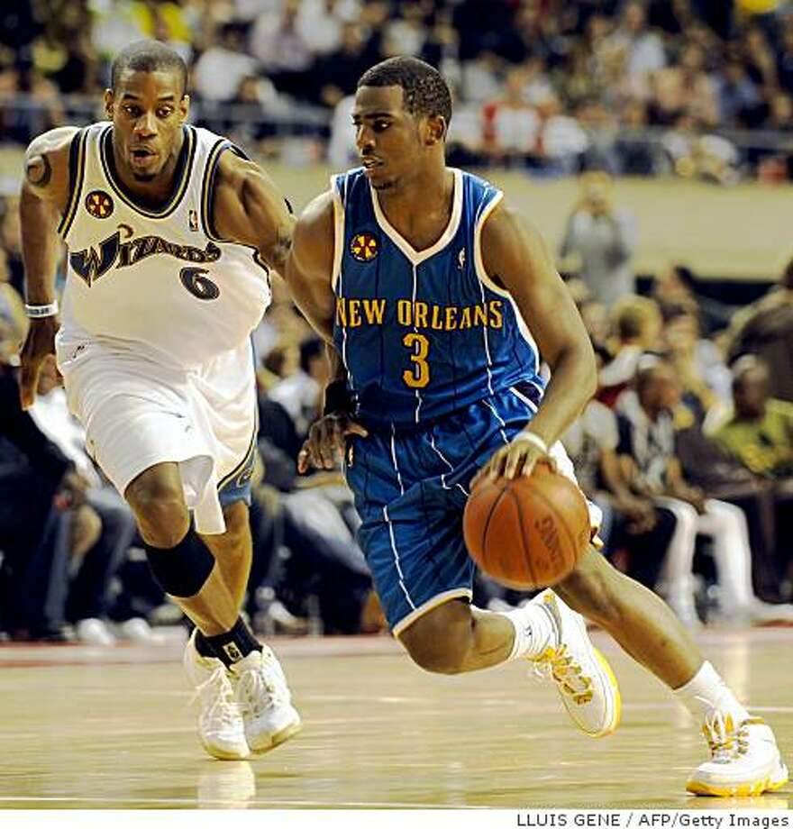 Antonio Daniels (L) of Washington Wizards vies with Chris Paul (R) of New Orleans Hornets during the NBA Europe Live 2008 Tour match at the Palau Blaugrana in Barcelona, October 17, 2008. AFP PHOTO/LLUIS GENE (Photo credit should read LLUIS GENE/AFP/Getty Images) Photo: LLUIS GENE, AFP/Getty Images