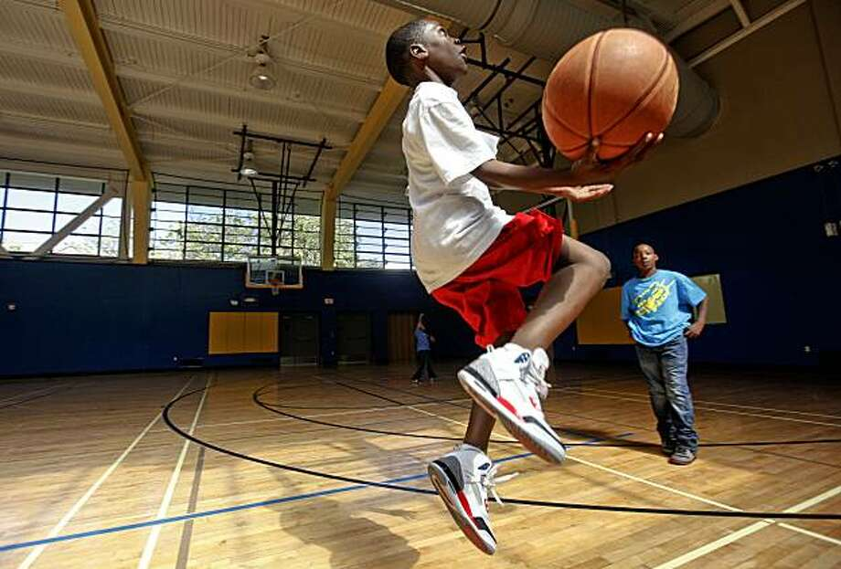 12-year-old Tyrese Johnson, (left) and 11-year-old Ivory Bivins shoot hoops on Monday May, 11, 2010, they are part of an after school program at Hamilton Recreation Center   Mayor Gavin Newsom, at the Hamilton Recreation Center in San Francisco, Calif., announced today that the city is expanding summer youth programs to help make up for the decline in the San Francisco Unified School District's summer programs as a result of state budget cuts. Photo: Michael Macor, The Chronicle